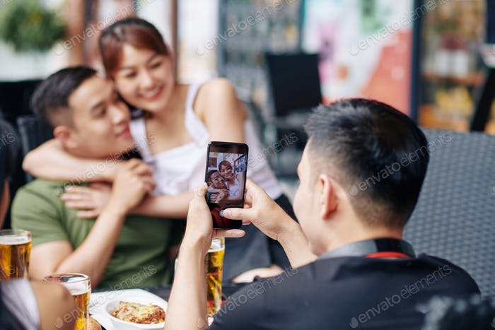 Couple photographing on the phone