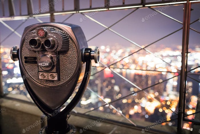 Binoculars on top of Empire State Building at Night in Manhattan