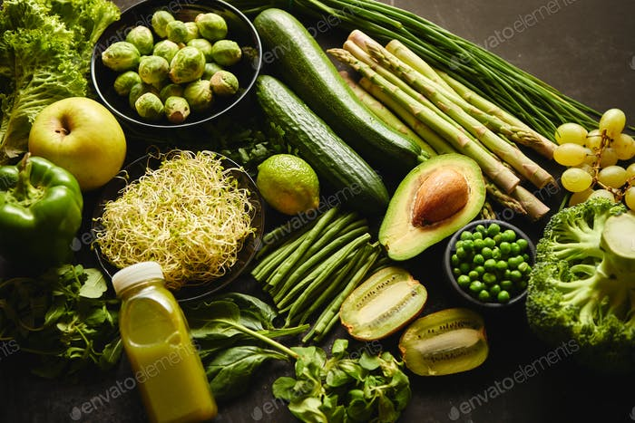 Green healthy food composition with avocado, broccoli, apple, smoothie...