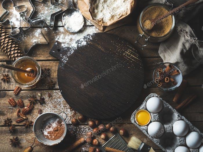 Weihnachtsferien Kochen und Backzutaten mit Brett in der Mitte