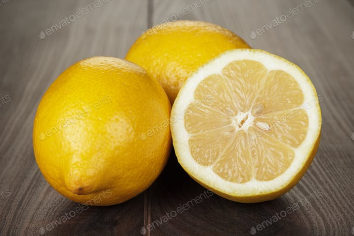 Fresh Lemons On The Wooden Table