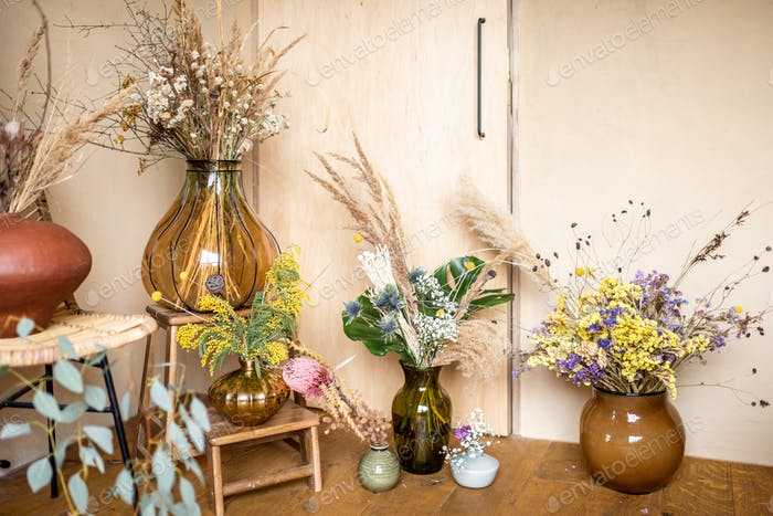Variety of different compositions of dried and fresh flowers