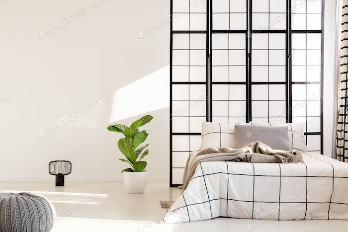 Black and white bedroom design with mullions wall