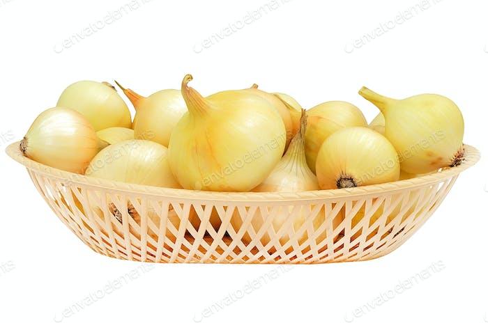 Onions in a plastic decorative bowl