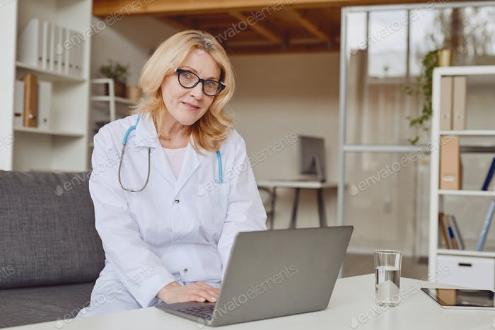 Mature Female Doctor in Clinic