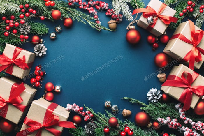 Christmas Frame with Gifts and Decorations on Dark Blue Background.