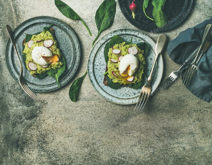 Healthy vegetarian breakfast flat-lay. Avocado and poached egg toasts