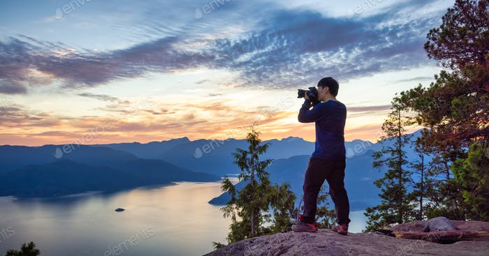 Adventure Photographer Hiking and taking pictures of Canadian mountain landscape
