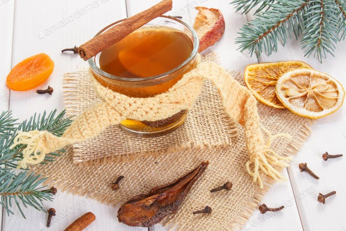 Spruce branches and traditional compote of dried fruits for Christmas