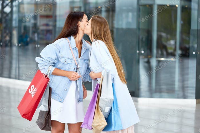 Girl Friends Meeting in Shopping Center