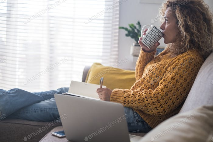 Relaxed and worried adult woman at home