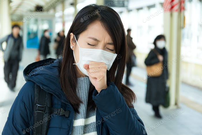 Woman feeling unwell in trains station