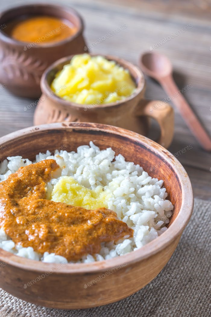 Bowl of rice with Indian butter sauce and Ghee