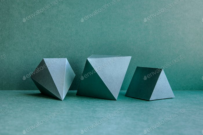 Geometrical figures on green background