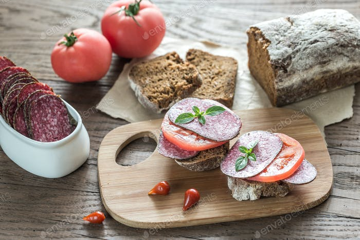 Sandwiches with salami and tomatoes