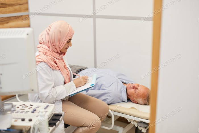 Arab Nurse Filling In Patients Form