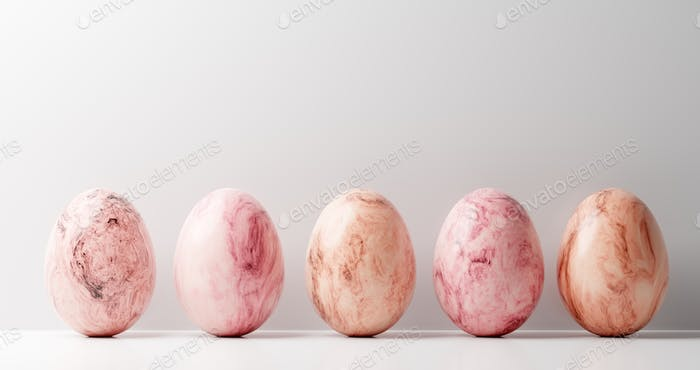 Marble Easter eggs on white background.