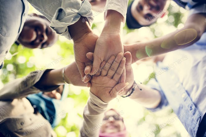 Group of diverse youth hands joined