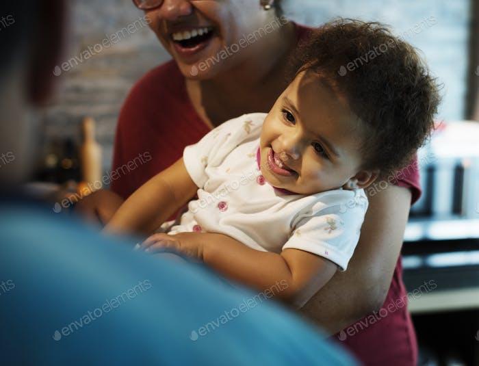 Closeup of smiling brazilian girl with mom