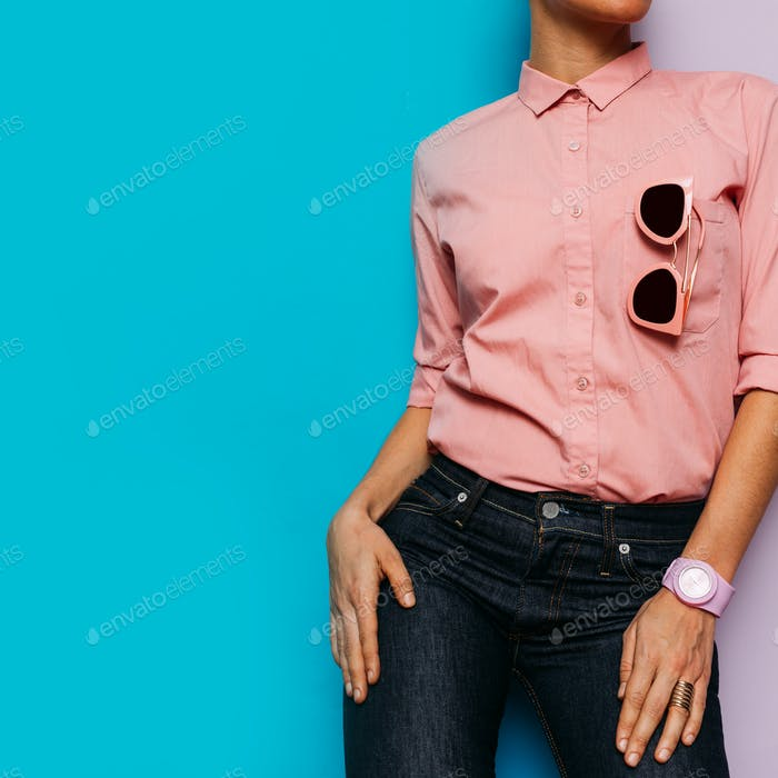 Girl in pink shirt and pink accessories. Watches and sunglasses.