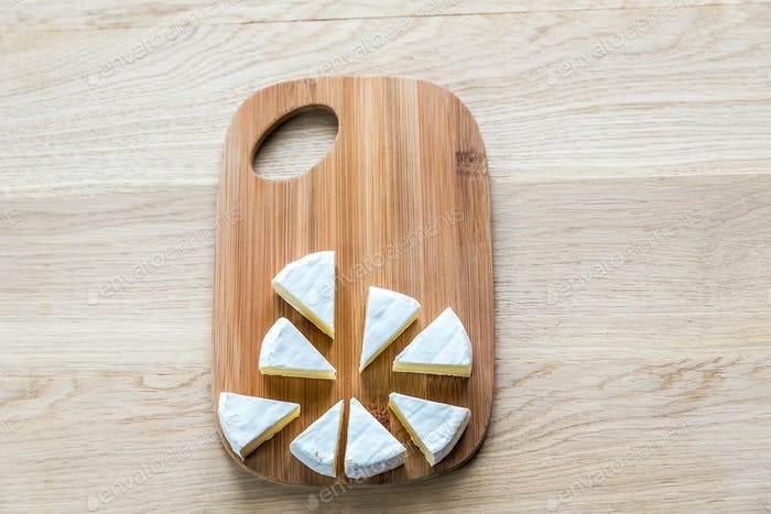 Camembert on the wooden board