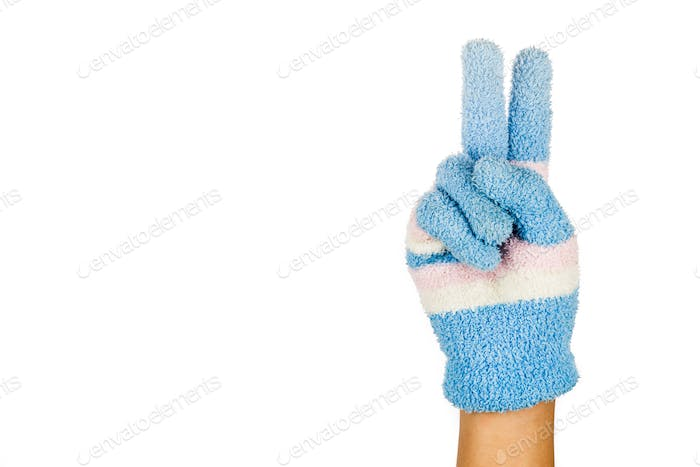 Hand in blue winter glove gesture number two against white backg