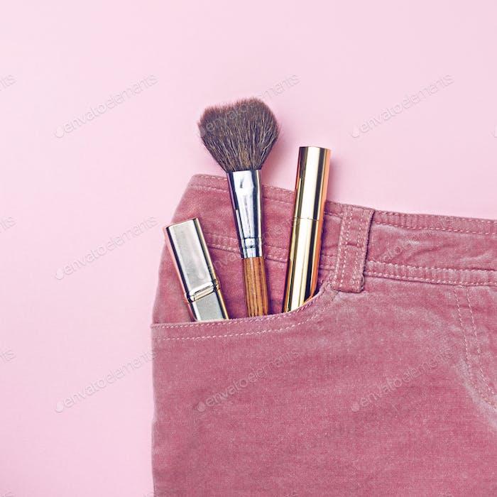 Small set of make-up in pink pants pocket