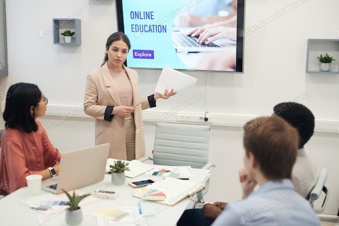 Young Woman Giving Presentation in Business Meeting