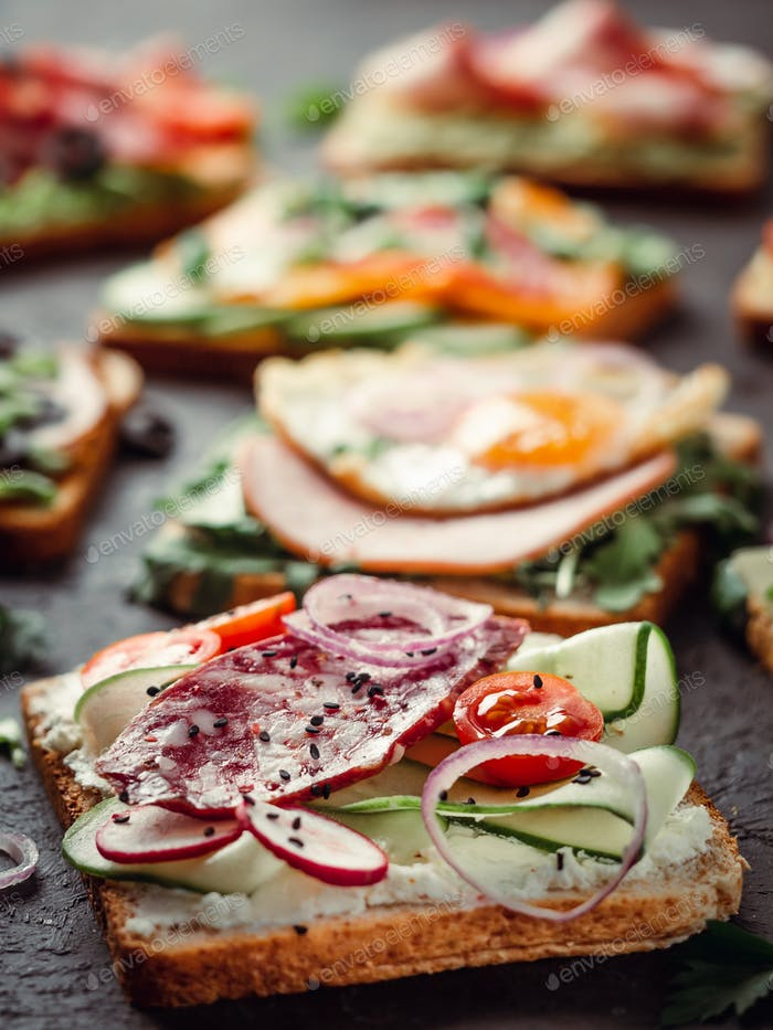 sandwiches with salami, vegetables and black sesame
