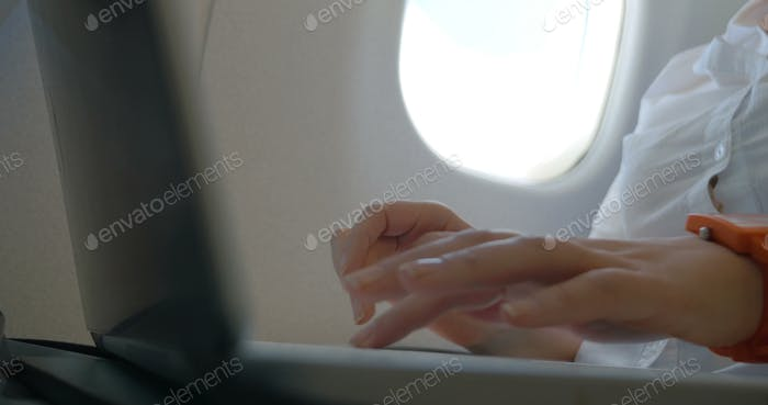 Female Hands Typing in Laptop