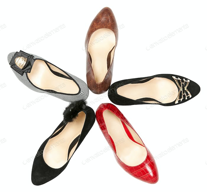 Women shoes in circle over white background