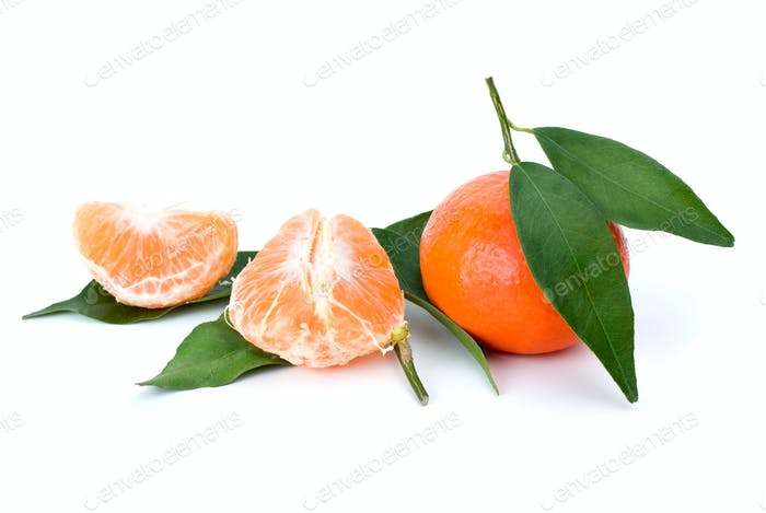 Whole and peeled mandarines and some mandarin leaves