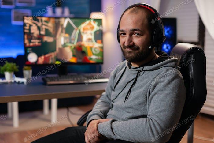 Winner gamer playing shooter videogames