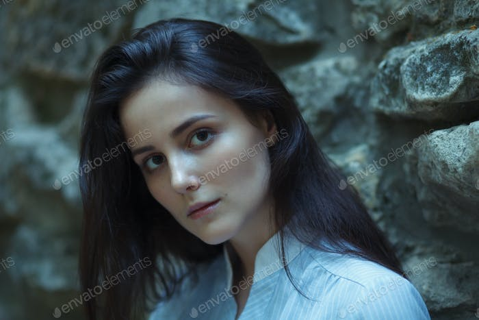 moody sombre female portrait in forest