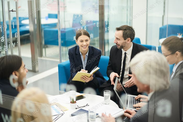 Cheerful Businesswoman in Meeting