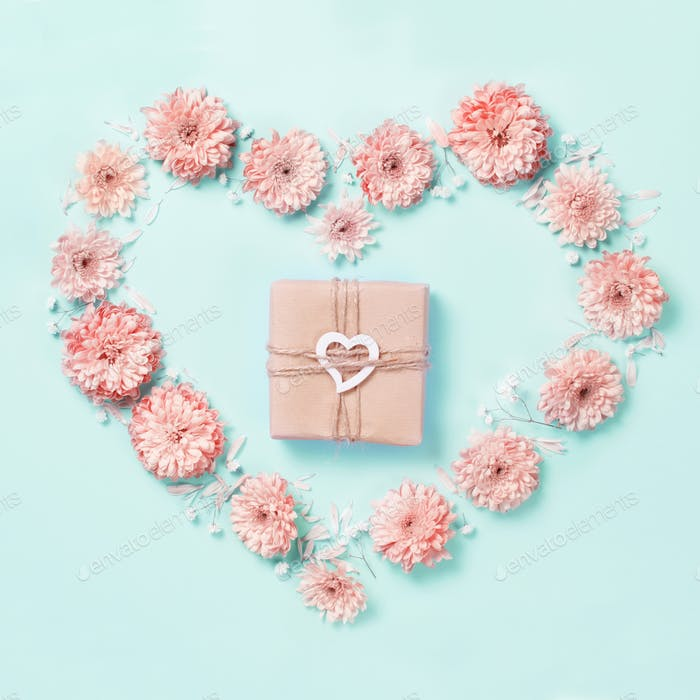 Heart symbol made of pink flower with gift box