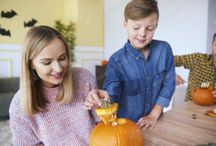Parent and child making carved pumpkin