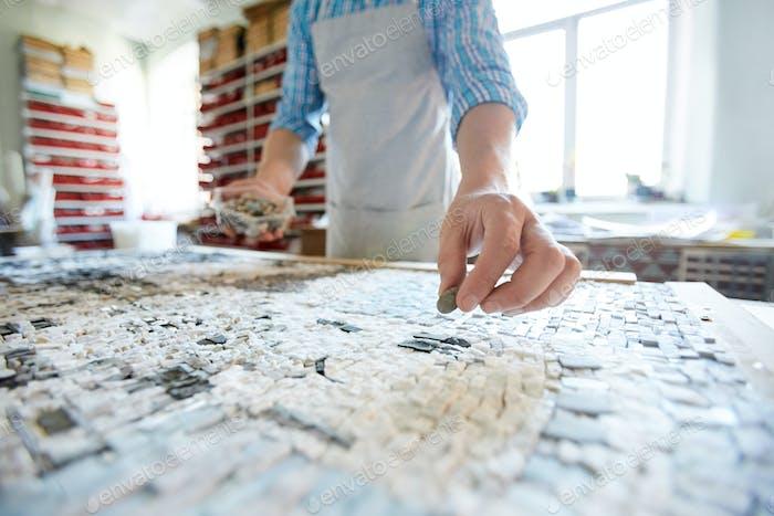 Man Creating Mosaic