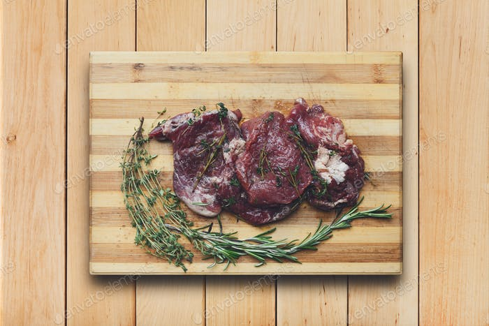 fresh beef meat on a cutting board