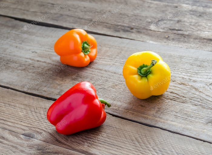 Bell peppers on the wooden background