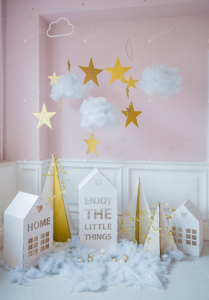 New year decoration. Tiny Christmas houses.Christmas background with white house, snowflakes, star