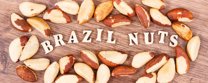 Inscription brazil nuts and fruits as source of natural minerals and vitamin
