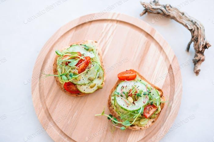 Tasty italian bruschetta on the wooden plate