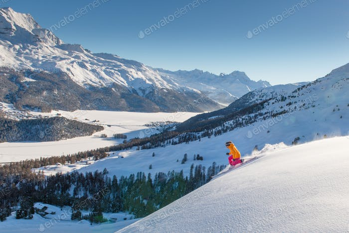 Girl telemark skier on the slope above the valley of lakes