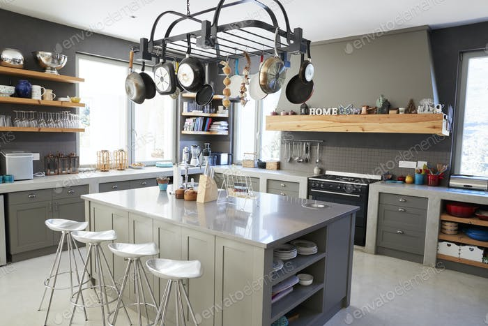 Kitchen Area Of Modern Home Interior With Island And Appliances