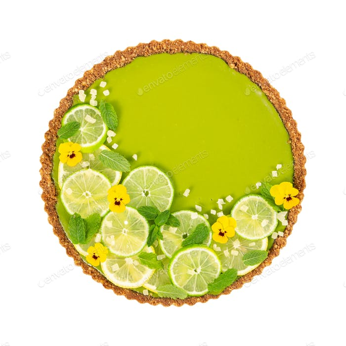 Cheesecake with slices of lime and lemon, fresh mint, candied fruit and pansy
