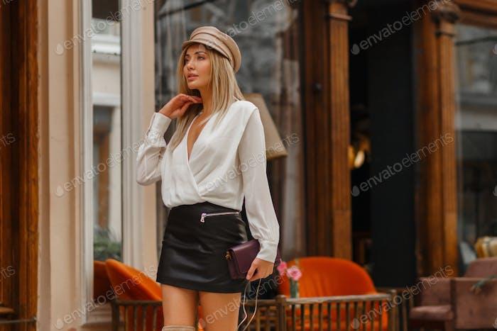 Blond model  walking on the  street.