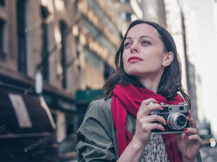 Young photographer with a retro camera