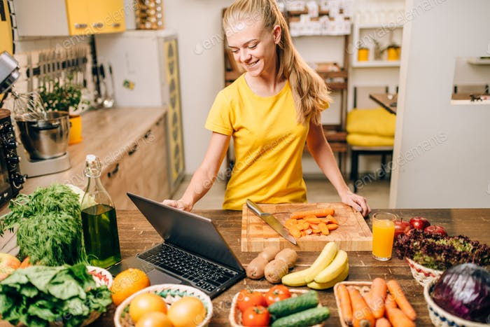 Young woman cooking on recipes, healthy food