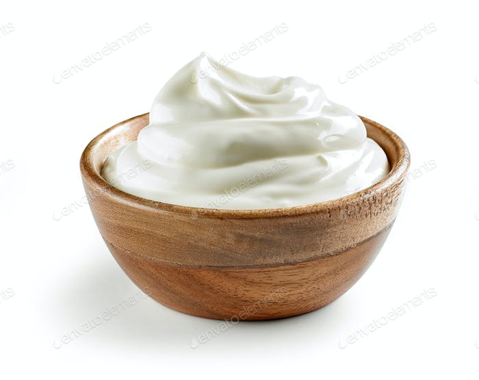 sour cream in wooden bowl